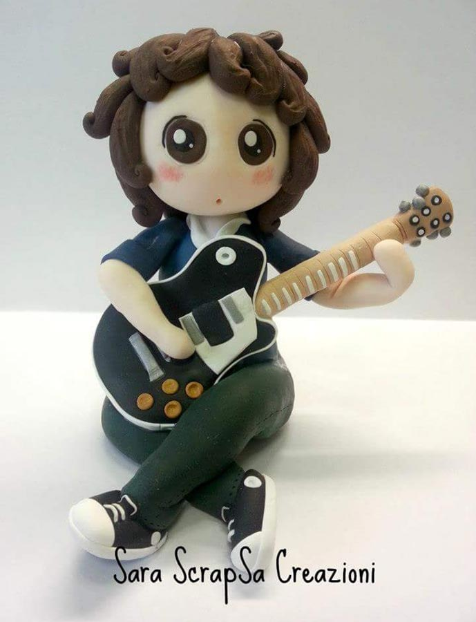 cake topper cresima musicista chitarra