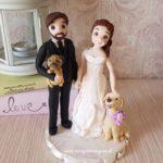 cake topper matrimonio con cani che portano le fedi