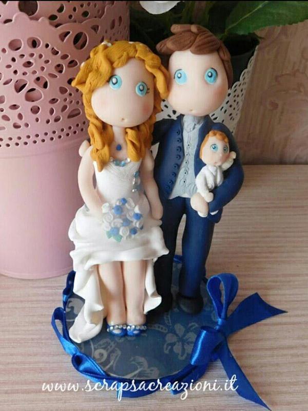 cake topper sposi con bambino realistico